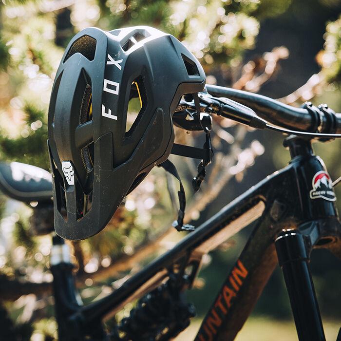 Speedframe helmet hanging on a mountain bike's handlebar.